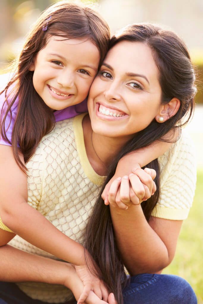 Portrait Of Hispanic Mother And Daughter In Park in Cibolo, TX