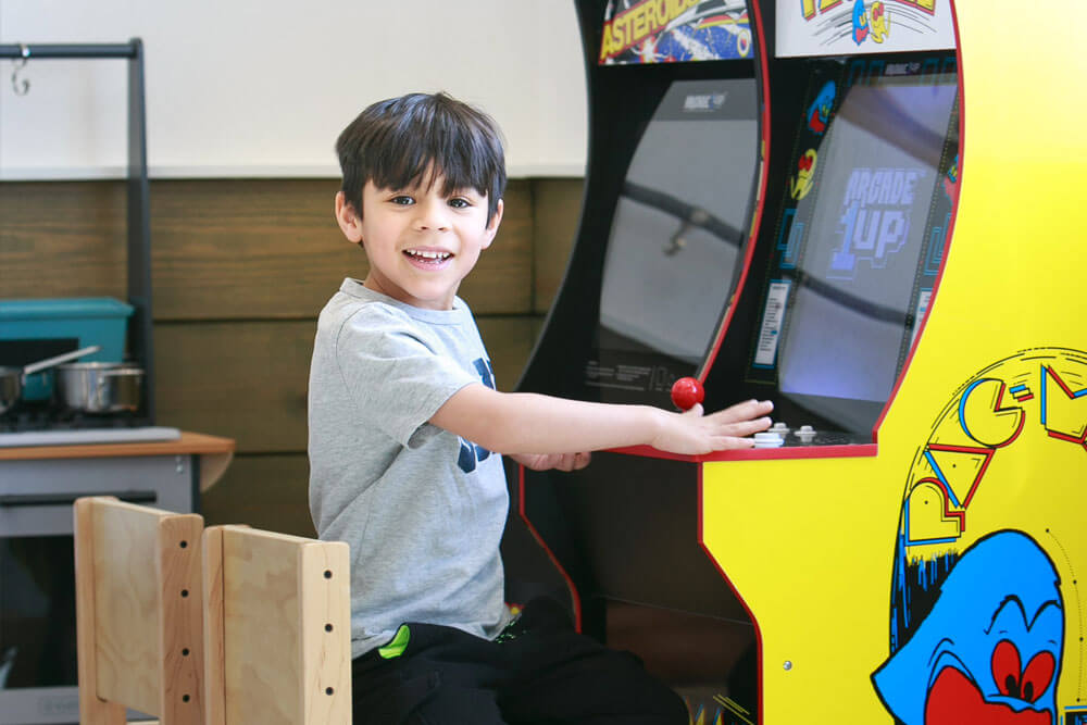 Young boy playing video games at Cibolo Pediatric Dentistry and Orthodontics