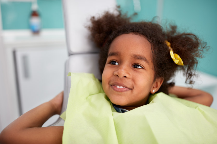 Smiling young girl in dental chair.